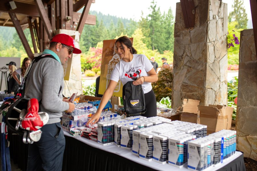 Players checking out SAXX sponsors table the Whiskey Wisemen Charity Tournament at Westwood Plateau Golf Club