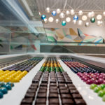 beta a store interior with rows of colourful chocolates at beta5