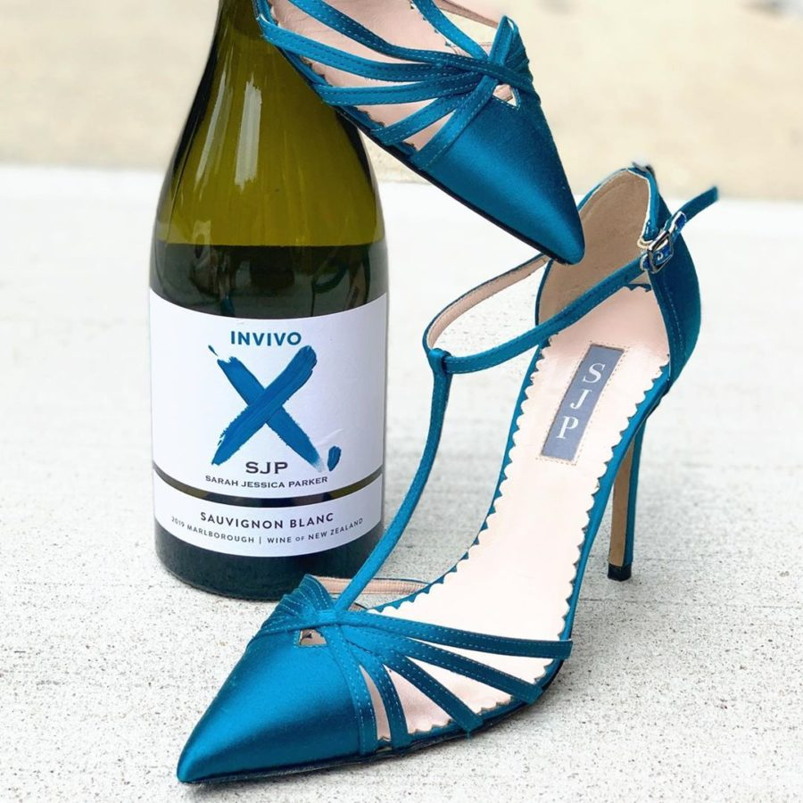 EcoLuxlifestyle showcases Blue Sarah Jessica Parker shoes with Invivo wine bottle
